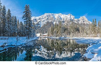 Scenic winter landscape in Bavarian Alps at idyllic monutain lake Hintersee