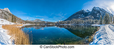 Scenic winter landscape in Bavarian Alps at mountain lake Hintersee