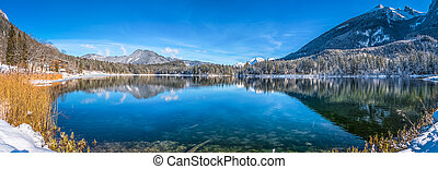 Scenic winter landscape in Bavarian Alps with idyllic mountain lake