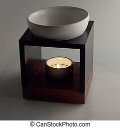 Scent diffuser over gray background, square image
