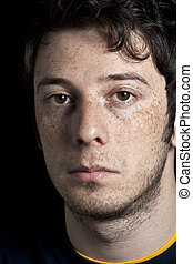 Sceptical Man with Freckles
