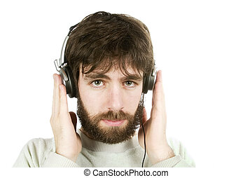 Sceptical Music - A young man looking sceptical while...