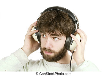 Sceptical Music - A young man looking sceptical while ...