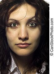 Sceptical Woman Raising Eyebrow