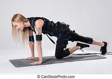 schöne , blond, in, ein, elektrisch, muskulös, klage, für, anregung, marken, ein, übung, auf, der, teppich