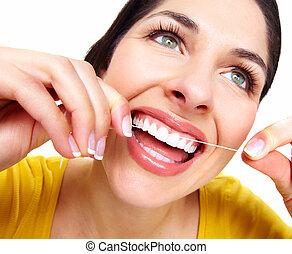 schöne frau, mit, a, dental, floss.