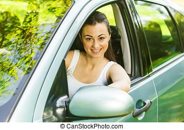 schöne , junge frau, fahren autos