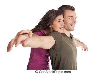 schöne , mögen, ehepaar., heiter, junger, liebenden, umarmen, und, lächeln, kamera, während, stehende , freigestellt, weiß