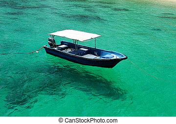 schöne , sandstrand, motorboot