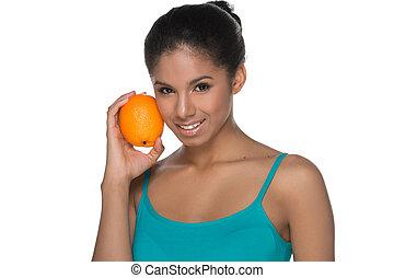 schöne , stehende , freigestellt, junger, während, orange., besitz, orange, lächeln, weißes, frauen