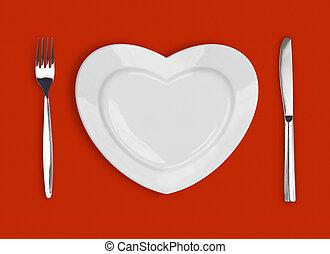 schaaltje, in vorm, van, hart, tafeel mes, en, vork, op, rode achtergrond