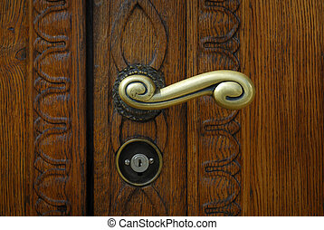 Schaffhausen - old wooden door with handle a modern lock -...