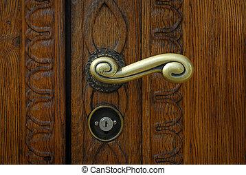 Schaffhausen - old wooden door with handle a modern lock -...