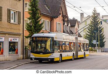 SCHAFFHAUSEN, SWITZERLAND - DECEMBER 01: A modern Hess Swiss Trolley 3 trolleybus in Schaffhausen on December 1, 2013. There is a single trolleybus route opened in 1966 in Schaffhausen.