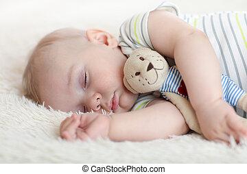 schattig, baby jongen, slapende, met, weinig; niet zo(veel), speelbal