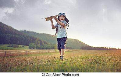 schattig, jongetje, spelend, speelgoed vliegtuig