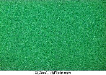 schaum, plastik, gummi, grüner hintergrund, stück