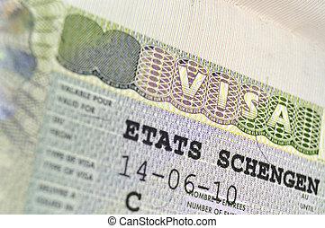 Schengen Visa - passport page fragment with issued Schengen...