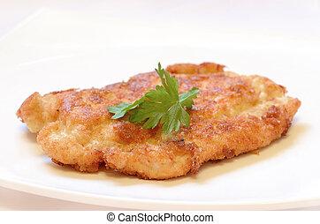 Schnitzel on white plate