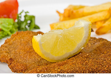 schnitzel - detail of a viennese schnitzel on a plate