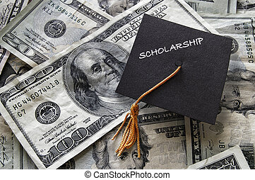 Scholarship graduation cap on cash