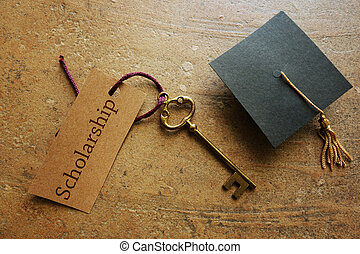 Scholarship key and cap - Gold key with Scholarship tag,...