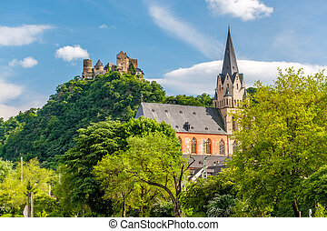 Schonburg Castle and Liebfrauenkirche (Church of Our Lady) at Rhine Valley (Rhine Gorge) near Oberwesel, Germany. Built some time between 1100 and 1149.