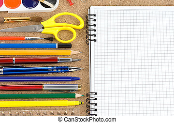 school accessories and checked notebook