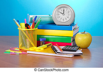 School accessories and clock - Pile of books, an exercise...
