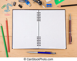 school accessories and notebook on wood