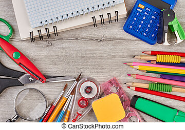 School accessories on wooden background.