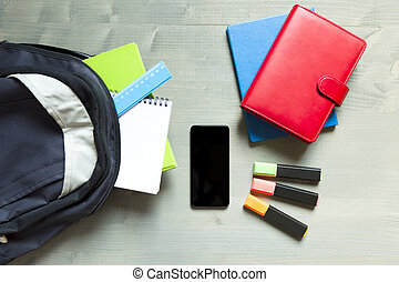 School and learning concept. Backpack with school supplies...