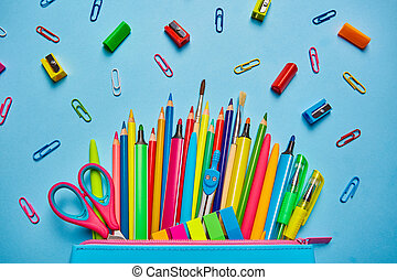 School background. Pencil case with bright office supplies