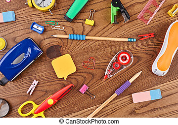 School background with different supplies.