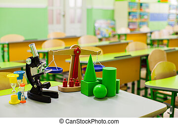 School background with educational accessories on the table