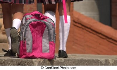 School Backpack And Students Walking