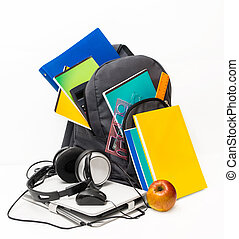School backpack with school supplies and a tablet with...