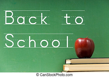 School books and chalkboard