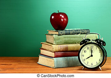 School Books, Apple and Clock on Desk at School - Back to...