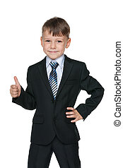 School boy holds his thumb up