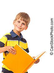 School boy is holding a book