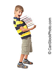 School boy is holding books. Back to school