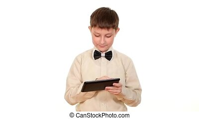 School boy looking for something using tablet computer, on white background, slow motion