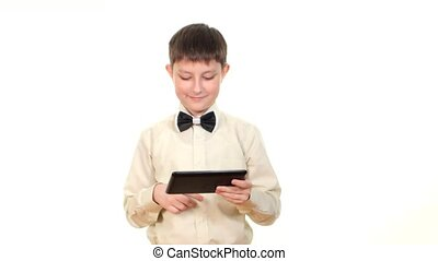 School boy looking for something using tablet computer, on white background