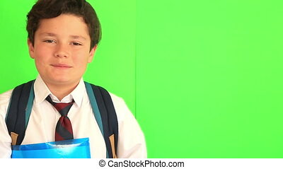 School boy on chroma key green screen background