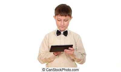 School boy playing using tablet computer, on white background, slow motion