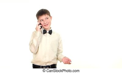 School boy talking to somebody using mobile phone, on white...