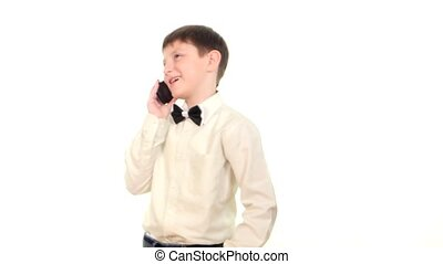 School boy using mobile phone and calls somebody on white background
