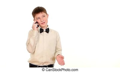 School boy using mobile phone and calls somebody on white...