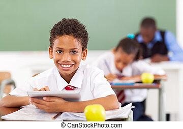 school boy using tablet computer - primary school boy using ...